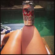 Hilary Duff Relaxing By The Pool - April 13, 2013